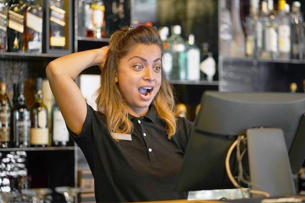 The waitress at the cash register