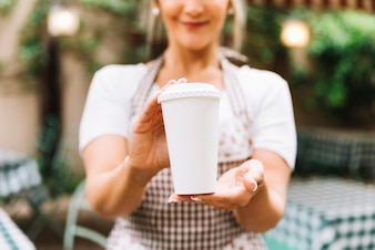 Waitress giving take away coffee