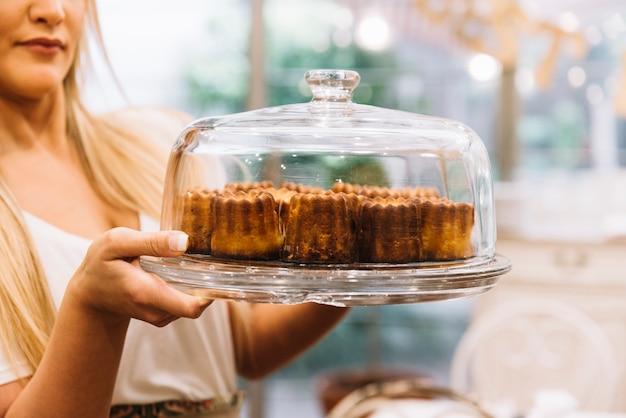 Waitress holding muffin tray
