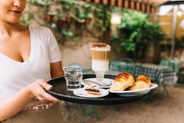 Waitress looking at tray