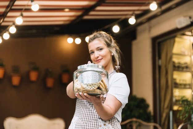 Waitress offering cookies