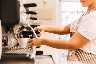 Waitress preparing coffee