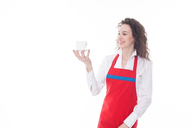 Waitress in red apron offering a cup of coffee isolated on white background