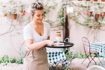 Waitress serving coffee