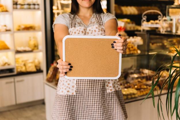 Waitress showing board