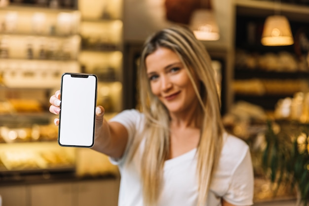Waitress showing mobile phone