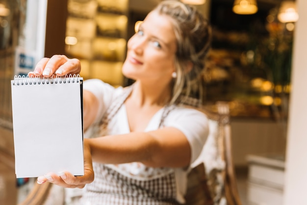 Waitress showing notebook