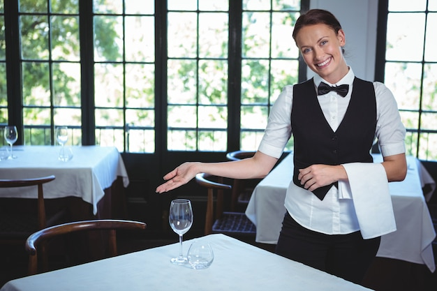 Waitress showing a table