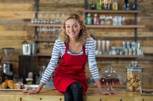 Waitress sitting at counter