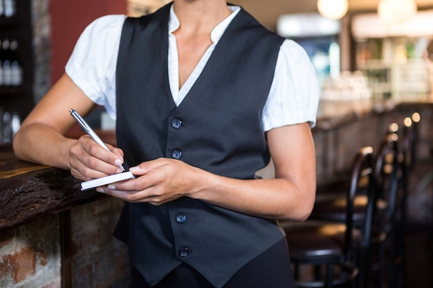 Waitress taking order on a notebook