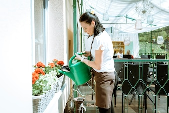 Waitress watering plants