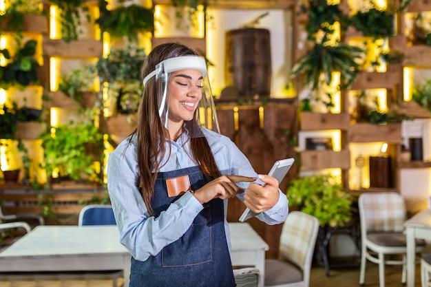 Waitress wearing apron at work
