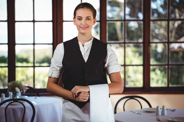 Waitress with napkin draped over her hand