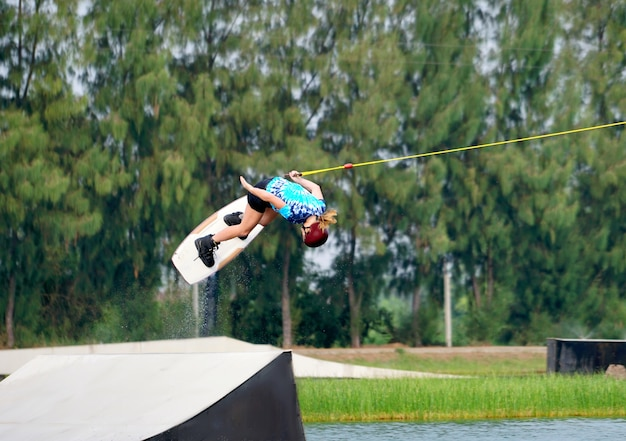 Wake boarding rider jumping
