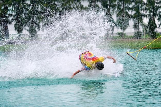 Wake boarding rider sliding and jumping trick