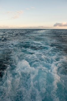 Wake formed by the moving ship in the ocean, galapagos islands, ecuador