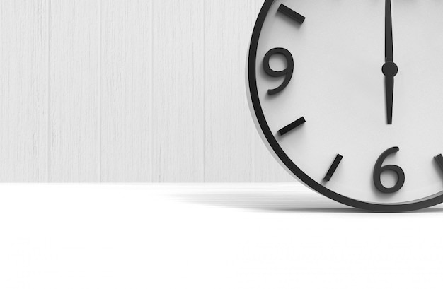 A wake up time at six clock on copy space white wood floor background.