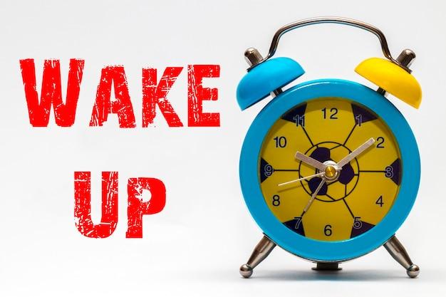 Wake up on a white background. retro alarm clock.