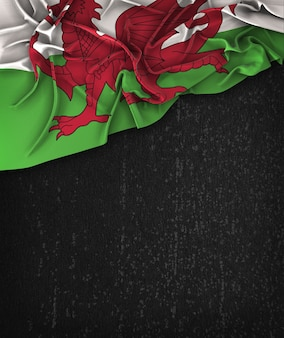 Wales flag vintage on a grunge black chalkboard with space for text