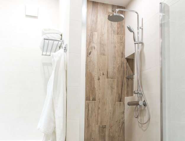 Walk in shower in bathroom with wooden style tile
