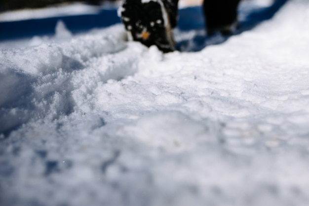 Walk on snowy path. close-up