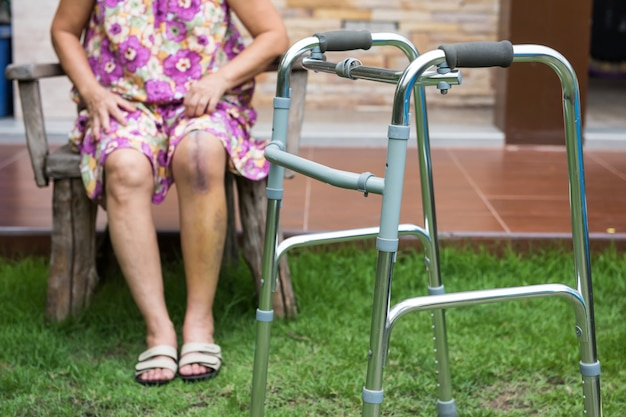 Walker frame for woman with leg surgery