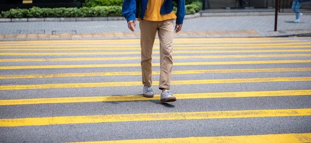 Walking across a pedestrian crossing, on foot across large city streets conceptual images of basic rights to use of public areas