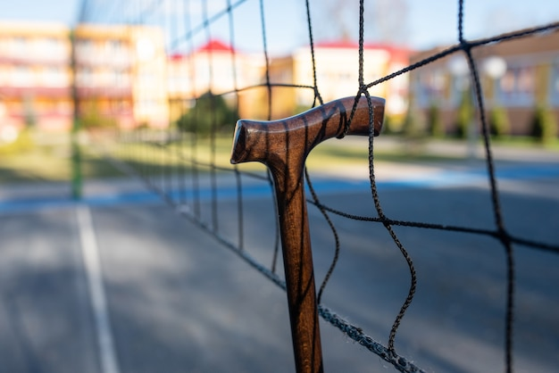 Walking stick hung on a volleyball net. for any purpose.