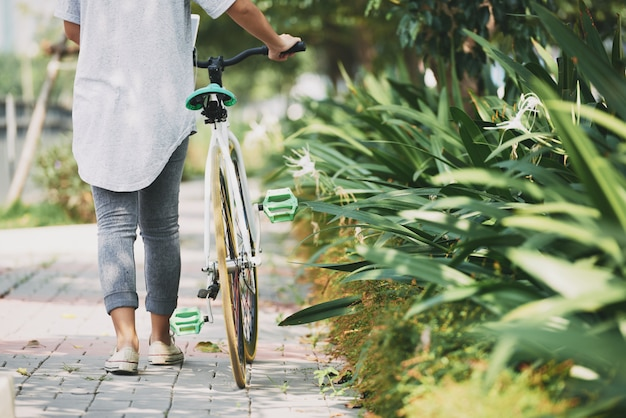 Walking with bicycle