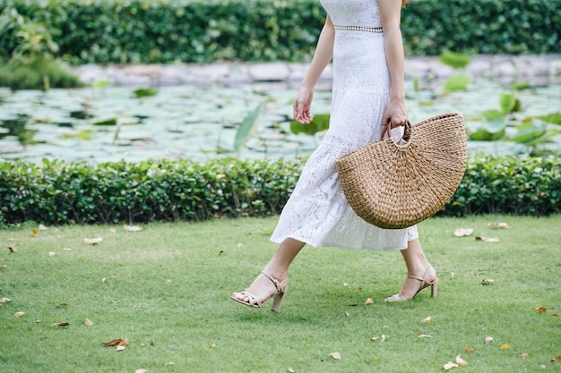Walking woman with straw bag