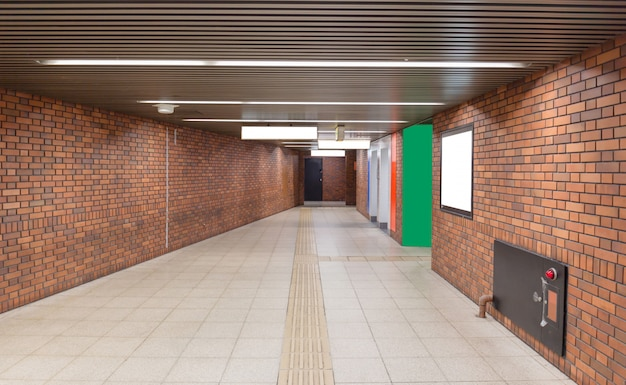 Walkway with brown brick wall to subway station