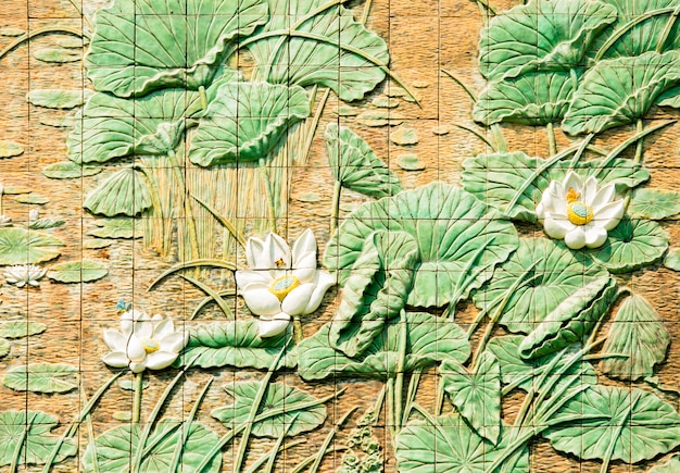 The wall are decorated with lotus pattern of tiles, texture background
