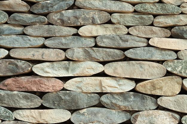 欠けた石で作られた壁の背景