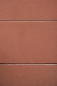 Wall of brown rock blocks