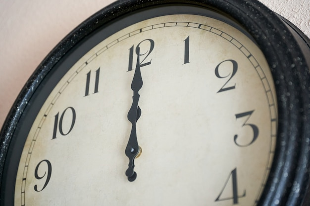 Wall clock marking twelve o'clock on the new year