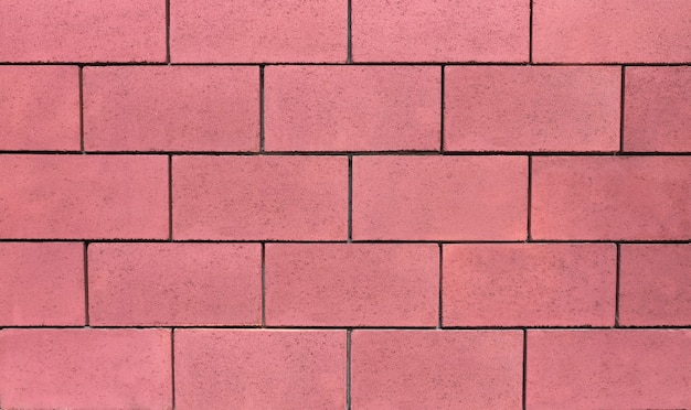 Wall of concrete blocks in pink, background