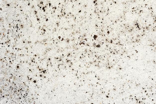 벽 콘크리트 질감 배경입니다. 긁힘과 균열이있는 벽 조각