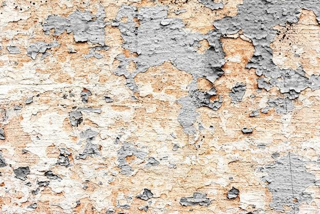 Предпосылка текстуры стены бетонная. фрагмент стены с царапинами и трещинами