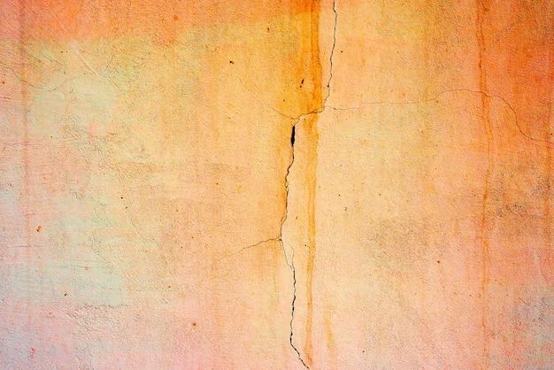 壁コンクリートテクスチャ背景。傷やひび割れのある壁の破片