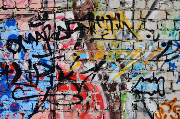 Wall decorated with colorful abstract graffiti.