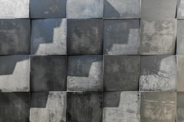 Отделка стен из квадратных бетонных плиток