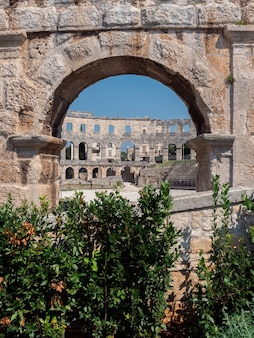 Wall fragment of the ancient roman amphitheater in pula, croatia