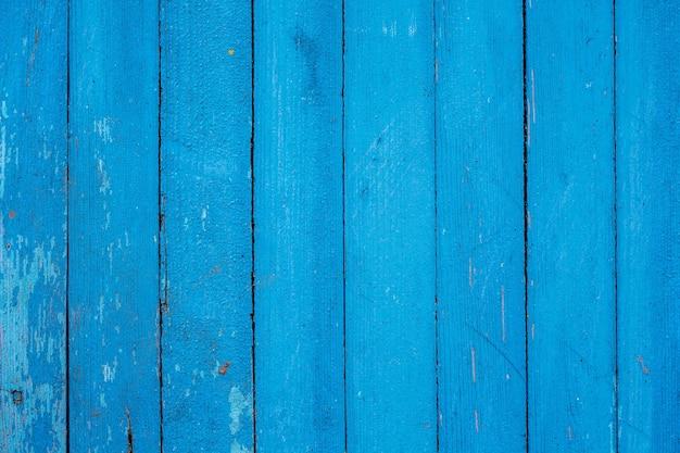 초라한 페인트로 오래 된 블루 보드에서 벽-배경 또는 질감
