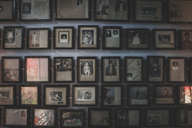 Wall full off old photos in photo frames