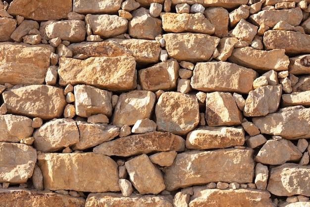 Wall of irregular yellow stones