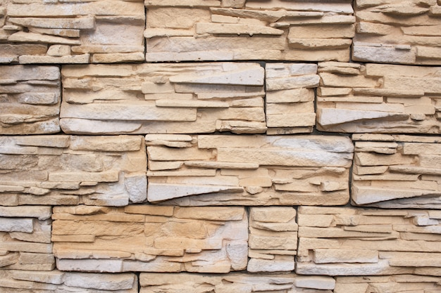 Wall is faced with tiles of  sandstone
