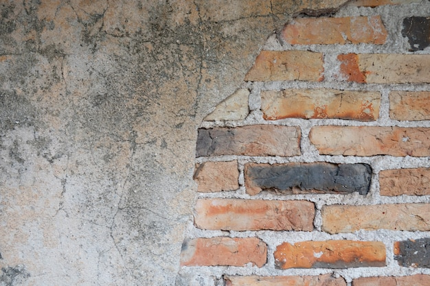 The wall is made of brick and then painted in white.