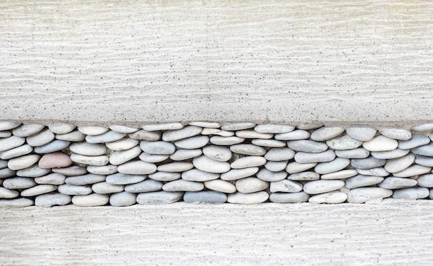 Настенный слой с камешками из камня и цемента, фон текстуры