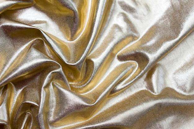Стена роскошная ткань или жидкая волна или волнистые складки гранжевого шелка текстуры сатина