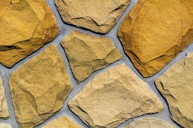 Wall made of natural limestone. irregular stones surface. seamlessr old stone texture background